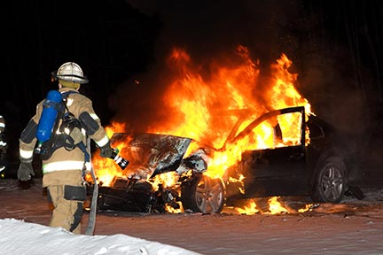 This is a photo of recue workers putting out a car fire. rescue workers respond to auto accidents, but you need a Car Accident Attorney to protect your rights.